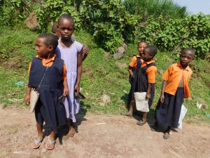 Pupils posing for a photo on their way to school